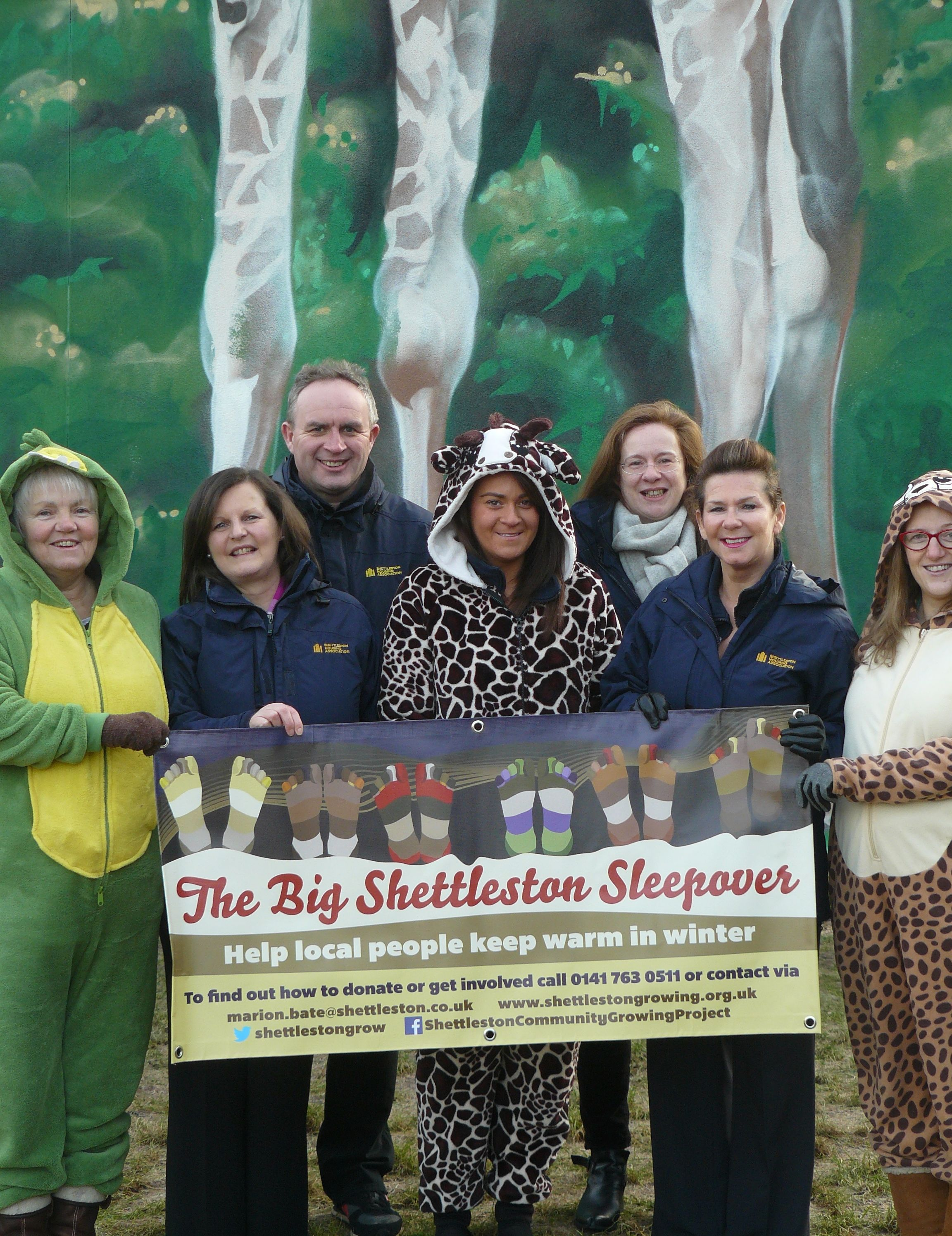 SHA staff holding banner promoting the Big Shettleston Sleepover