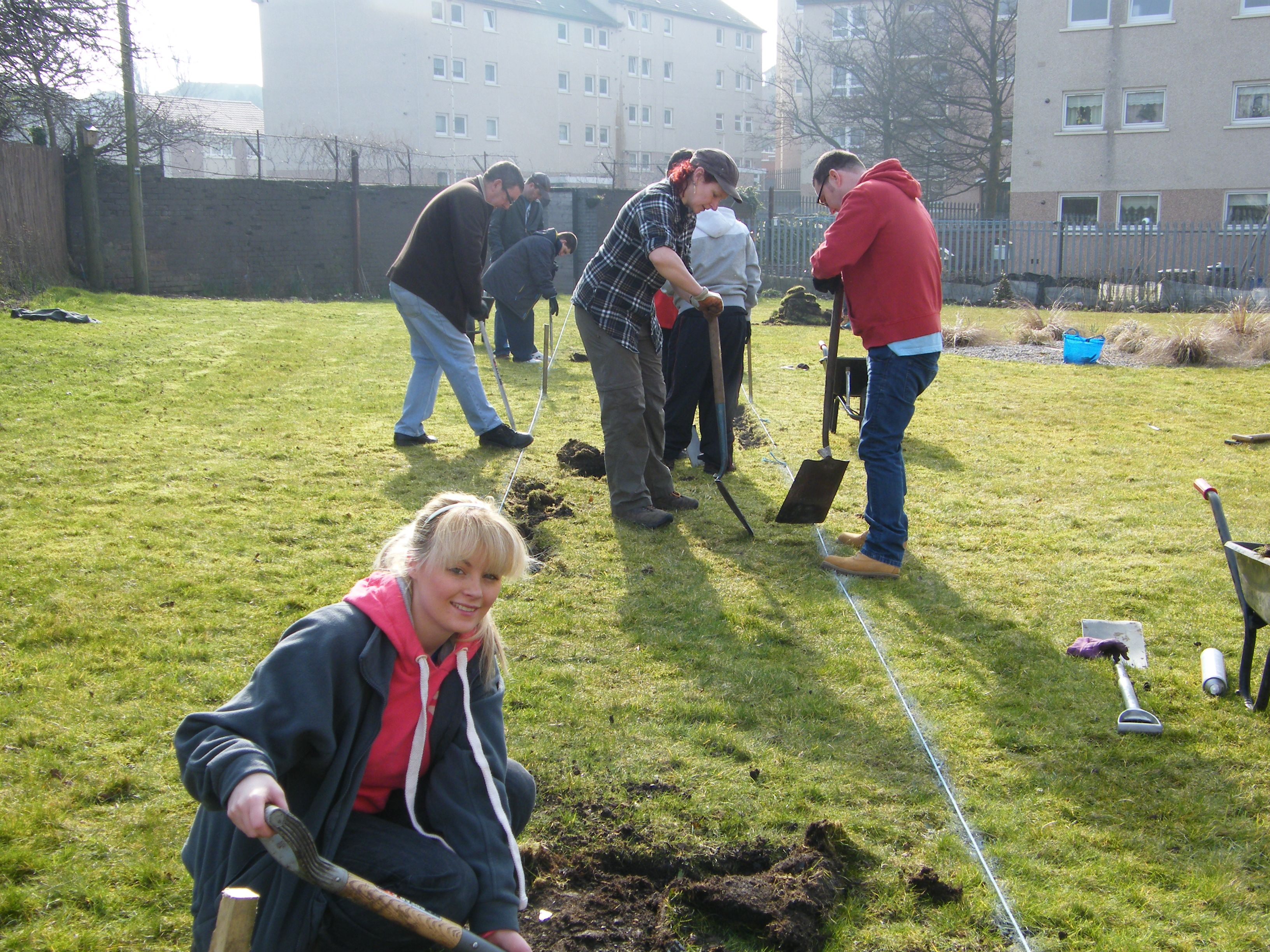 Volunteers building a path in the community garden