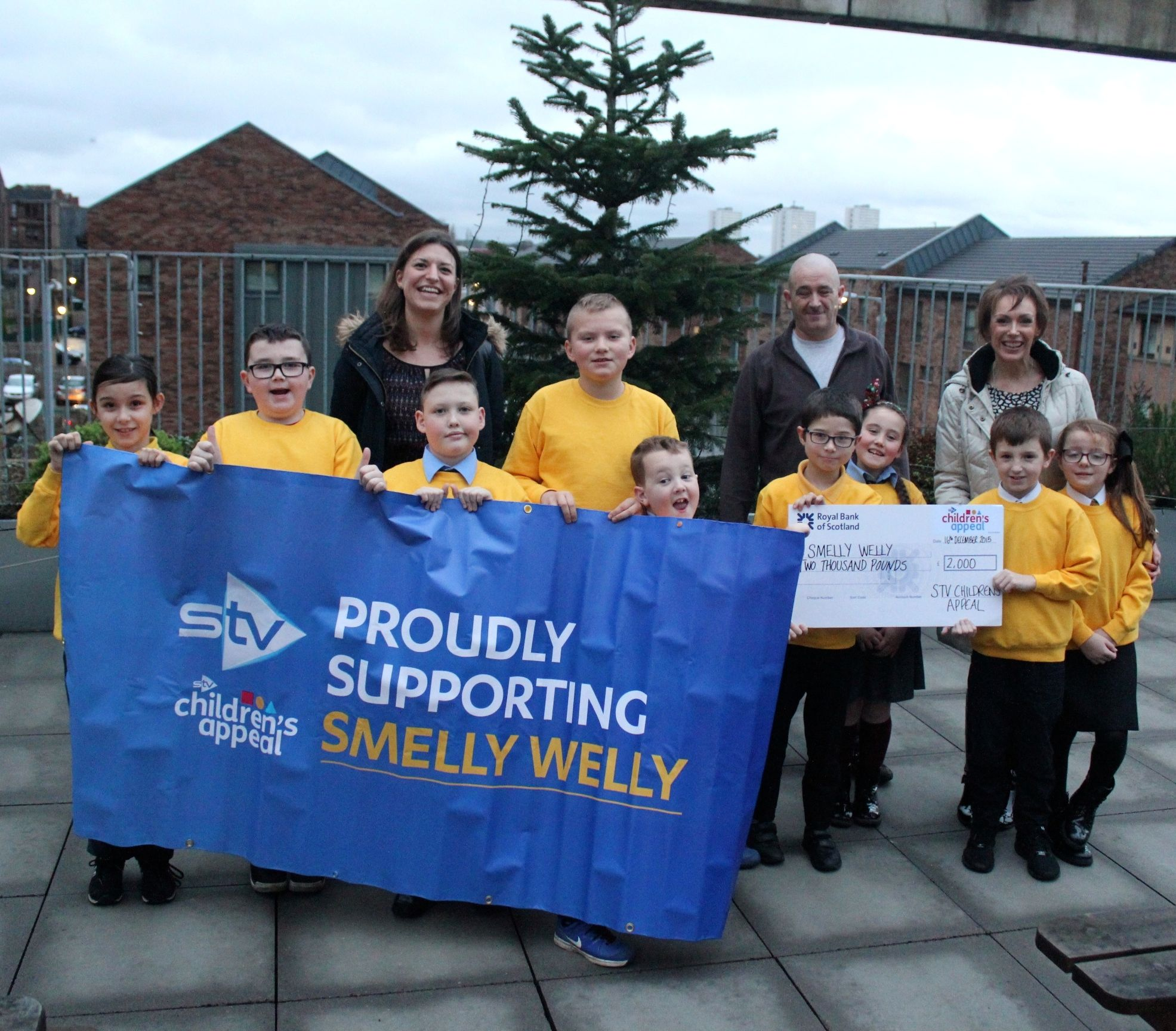 STV Appeal present Smelly Welly Club with £2000 cheque